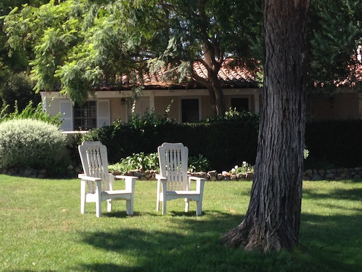 Inn at RSF chairs under tree