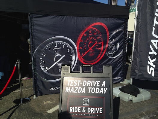 Car show - Mazda test drive sign