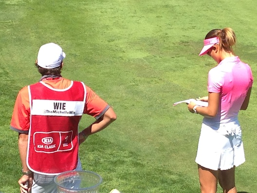 Michelle Wie and caddy